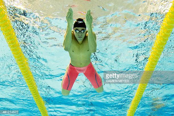 This picture taken with an underwater camera shows Thiago Pereira of Brazil competing in the men's 200m individual medley preliminary at the Pan...