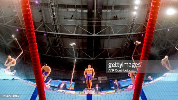 This picture taken with an underwater camera shows US Caeleb Remel Dressel preparing to compete in the men's 100m butterfly final during the swimming...