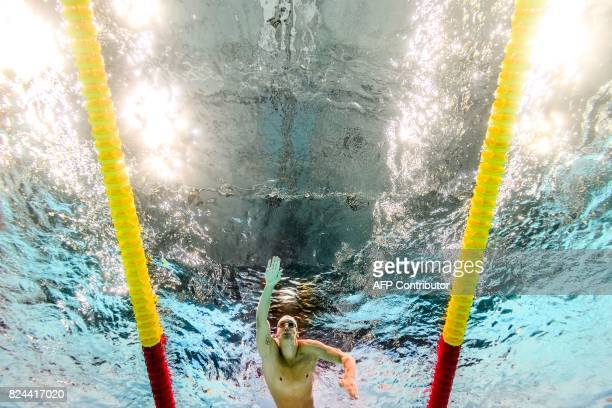TOPSHOT This picture taken with an underwater camera shows US Chase Kalisz competing in a heat of the men's 400m individual medley during the...