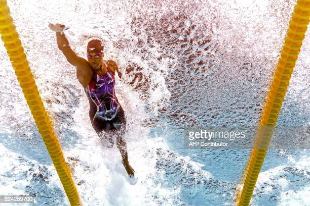 This picture taken with an underwater camera shows US Simone Manuel competing in a semifinal of the women's 50m freestyle during the swimming...