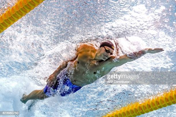 This picture taken with an underwater camera shows USA's Caeleb Remel Dressel competing in the men's 50m freestyle semifinal during the swimming...