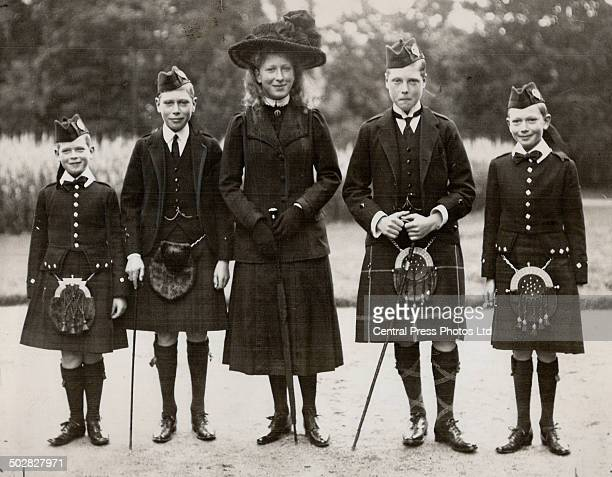 This picture was taken in 1912 when the dukechristened Prince George Edward Alexander Edmund was nine years old Left to right are shown Prince George...