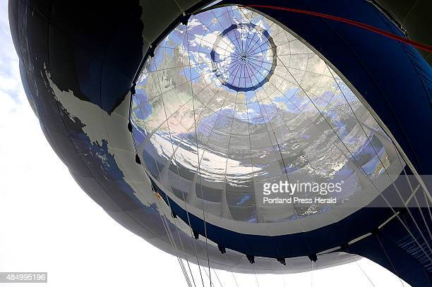 This Planet Earth Balloon piloted and owned by Doug Grimes is made of 436 panels made from digital photographs taken of the earth by astronauts in...