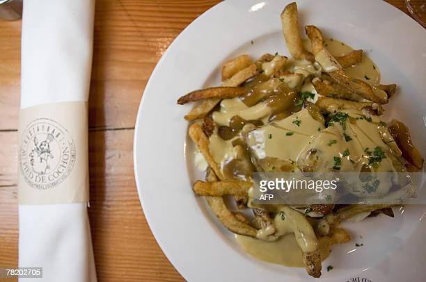 This Poutine au Fois Gras is prepared at Le Pied de Cochon 28 November 2007 in Montreal Quebec Canada The traditional dish born towards the end of...