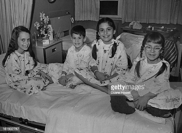 JAN 5 1965 JAN 6 1965 This Quartet had a Grand Opening It was a tonsillectomy of togetherness for Nadine 8 Mark 6 Nanette and Natalie children of Dr...