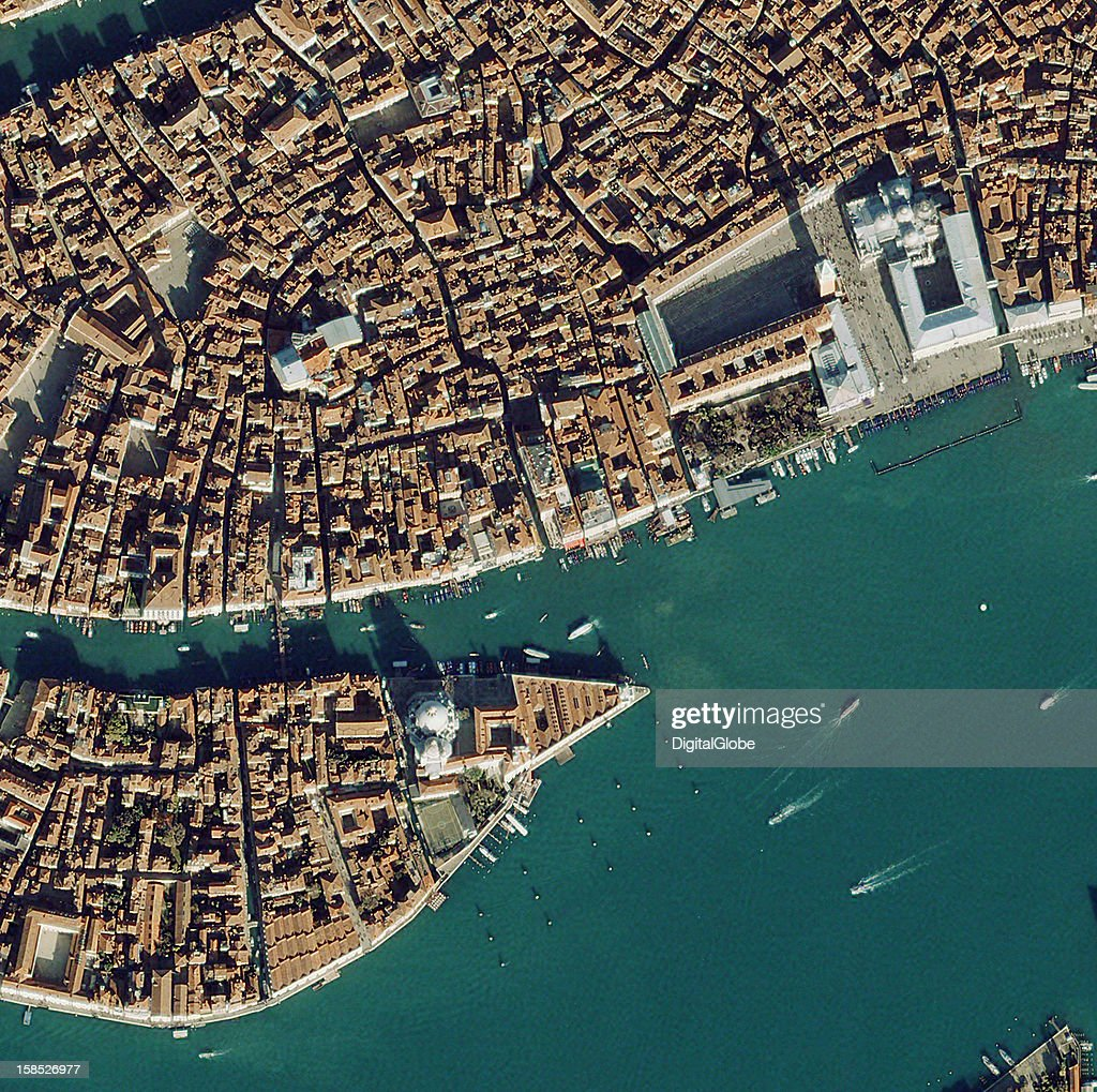 This satellite image features Venice, Italy and the Basilicia di Santa Maria della Salute (Basilica of St. Mary of Health). The structure was built in response to the devastating plague. Because the city was saved, the Venetian Senate declared that people would visit the church each year on November 21st in a celebration know as Festa della Madonna della Salute (Feast Day of the Basilicia of St Mary of Health).