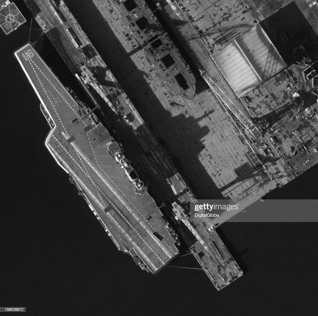 DECEMBER 4, 2012- This satellite image from December 4, 2012 shows extensive tire skid marks under the arrestor cables, attesting to numerous landings of J-15s as reported by China's defense ministry.