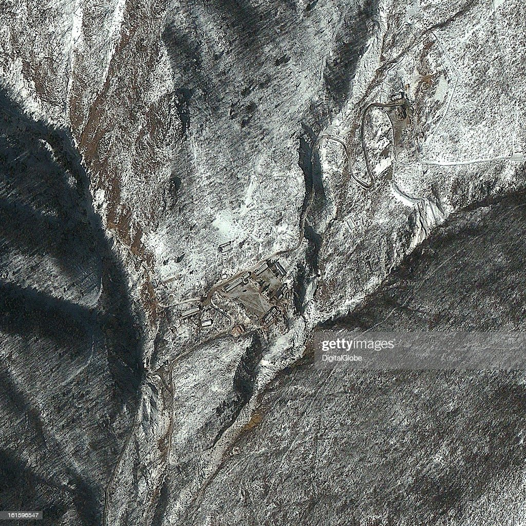 This satellite image of the Punggye-ni Nuclear Test Facility in North Korea from February 11, 2013 at 10:30 am local time, was collected approximately 24 hours before seismic activity was reported at this location. In this image, activity is noted at the northern end of the facility where disturbed earth suggests that there is an active tunnel entrance. Throughout the facility the roads are clear of snow, and there is a vehicle present in the main parking area.