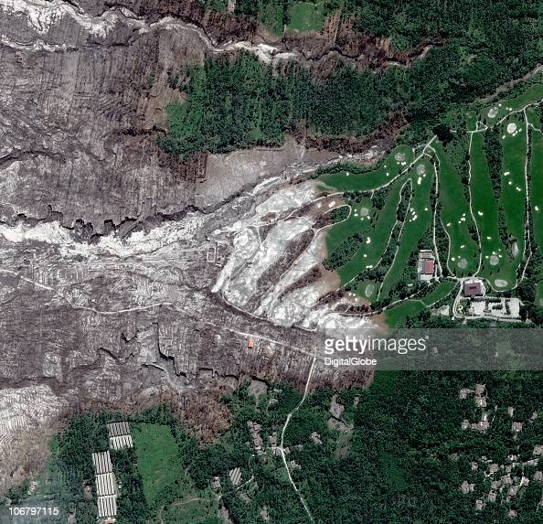 This satellite image shows the eruption and lava flowing into the Merapi Golf Course in Yogyakarta on November 11 2010 of Mount Merapi Indonesia The...