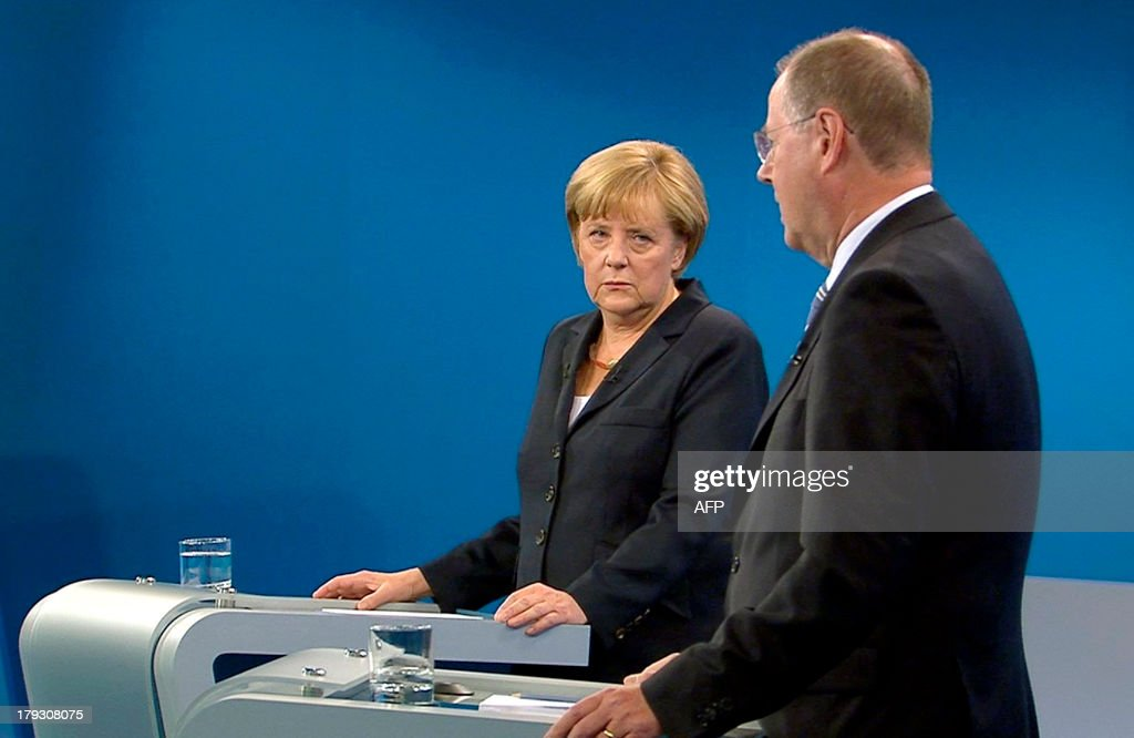 This screenshot made available by public broadcaster ARD shows German Chancellor Angela Merkel (L) and her challenger Peer Steinbrueck of the SPD during a television debate in Berlin on Septeember 1, 2013 ahead of the General election taking place on September 22. AFP PHOTO / POOL / WDR / RTL / MAX KOHR CREDIT 'AFP PHOTO / POOL / WDR / RTL MAX KOHR' - NO