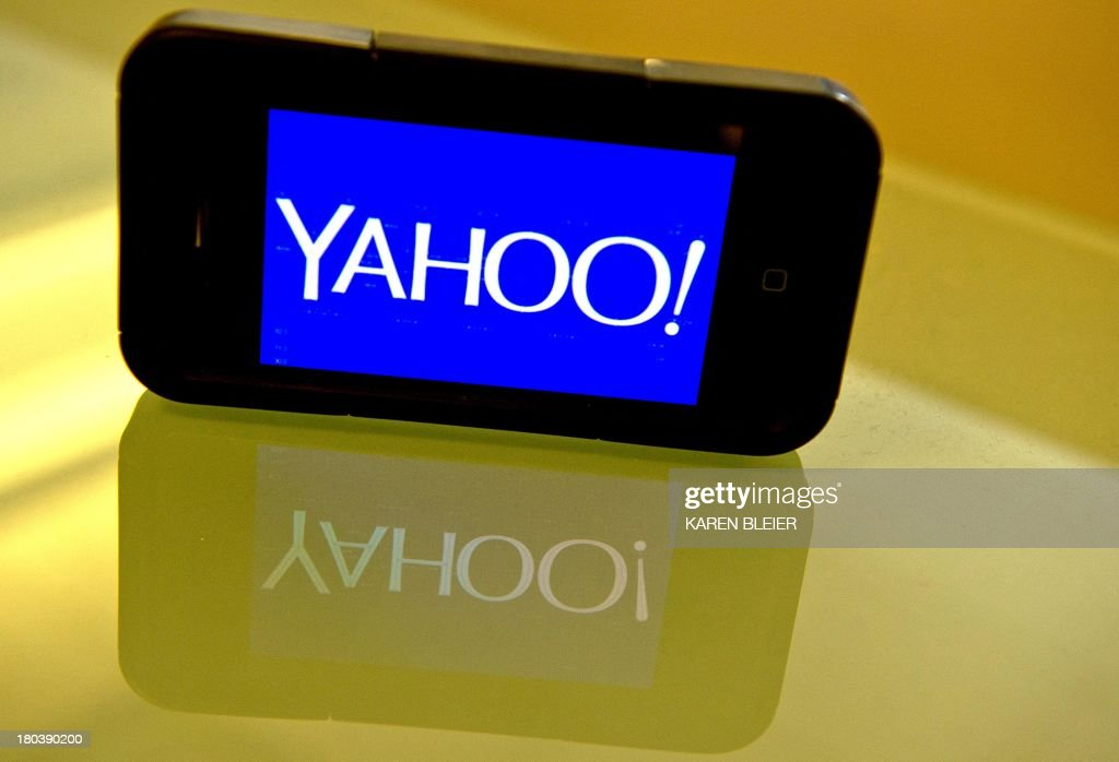 This September 12, 2013 photo illustration shows the newly designed Yahoo logo seen on a smartphone. Yahoo has refreshed its logo for the first time since the Internet companys founding 18 years ago. The new look unveiled September 4 is part of a makeover that Yahoo Inc. has been undergoing since the Sunnyvale, California company hired Google executive Marissa Mayer to become Yahoos CEO. AFP PHOTO / Karen BLEIER