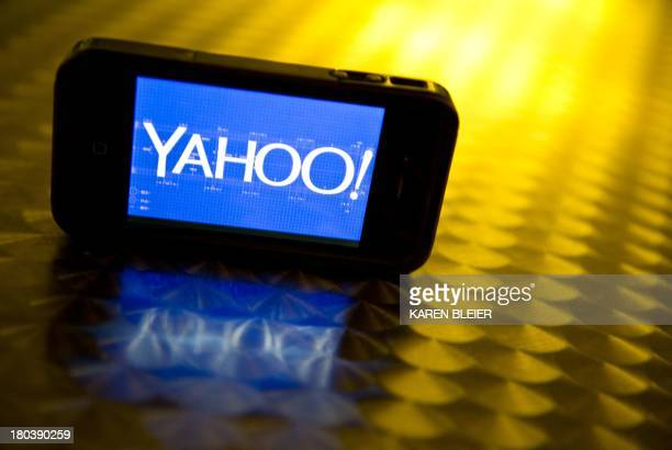 This September 12 2013 photo illustration shows the newly designed Yahoo logo seen on a smartphone Yahoo has refreshed its logo for the first time...