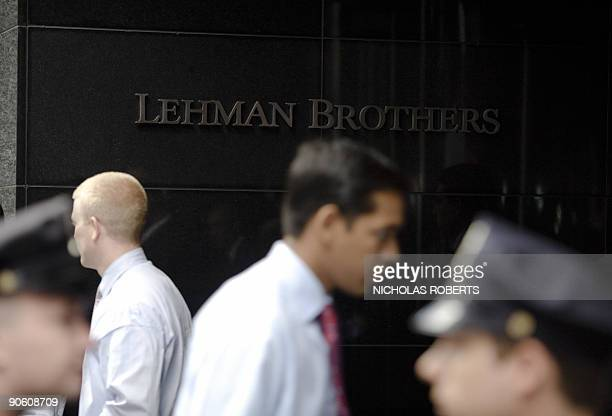 This September 15 2008 file photo shows people walking past Lehman Brothers headquarters the sign for Lehman Brothers headquarters in New York The...