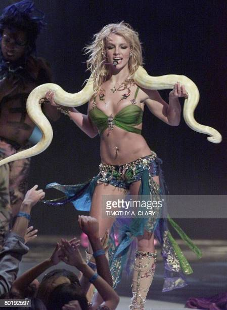 This September 6 2001 file photo shows US pop star Britney Spears performing with a snake draped over her shoulders at the 2001 MTV Video Music...