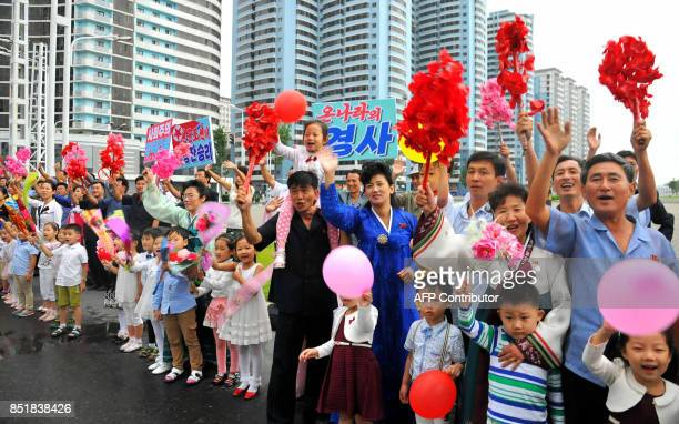 This September 6 2017 picture released from North Korea's official Korean Central News Agency on September 7 2017 shows Pyongyang residents greeting...