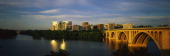 This shows sunrise over the Key Bridge on the Potomac River The skyline of Rosslyn Virginia is in the background