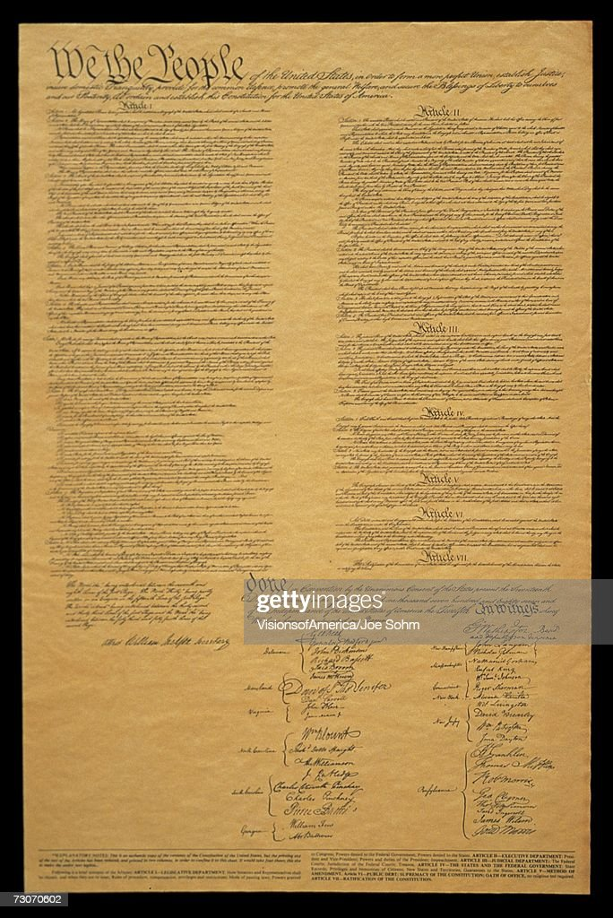 This shows the entire original U.S. Constitution on its faded parchment paper. The document begins with he phrase We The People and shows the signatures at the end of the historic document. : Stock Photo