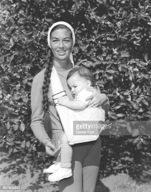 This sling childcarrier pictured here with actress Lois Lawson will solve a weighty problem for young mothers It's made of double reinforced canvas...