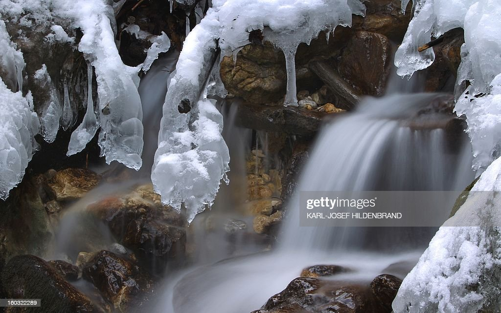 This slow-shutter-speed exposure shows water flowing through ice and snow near Hohenschwangau, southern Germany, on January 29, 2013. AFP PHOTO / KARL-JOSEF HILDENBRAND GERMANY OUT