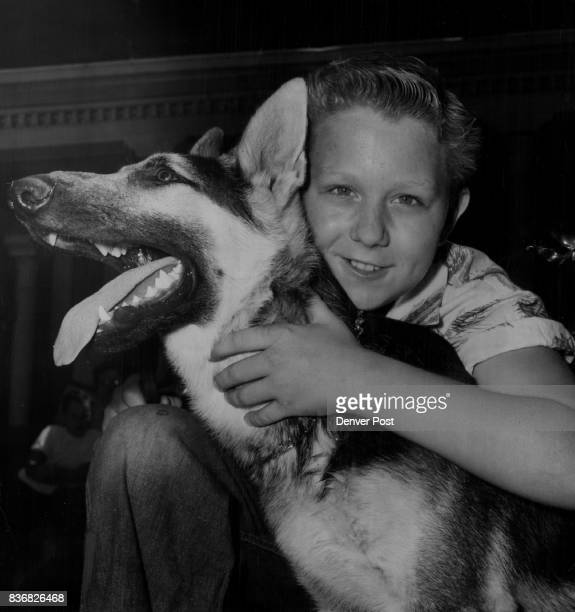 This smile illustrates Eddie Hoover's happiness as he hugs Rowdy a fivemonthold German Shepherd given to Eddie as a replacement for his dog Ginger...