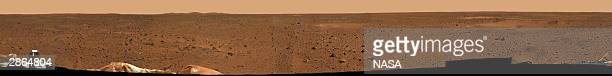 This sweeping mediumresolution version of the first 360degree panoramic view of the Mars surface taken by the rover Spirit's panoramic camera was...