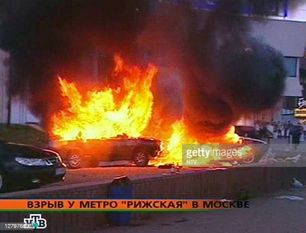 This TV grab image taken from Russian NTV channel 31 August 2004 shows a burning cars at the parking place near Rizhskaya subway station in Moscow At...