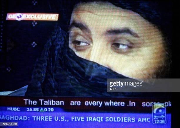 This TV grab taken 15 June 2005 from the Pakistani private television channel GEO shows a key Taliban commander Mullah Akhtar Usmani answering a...