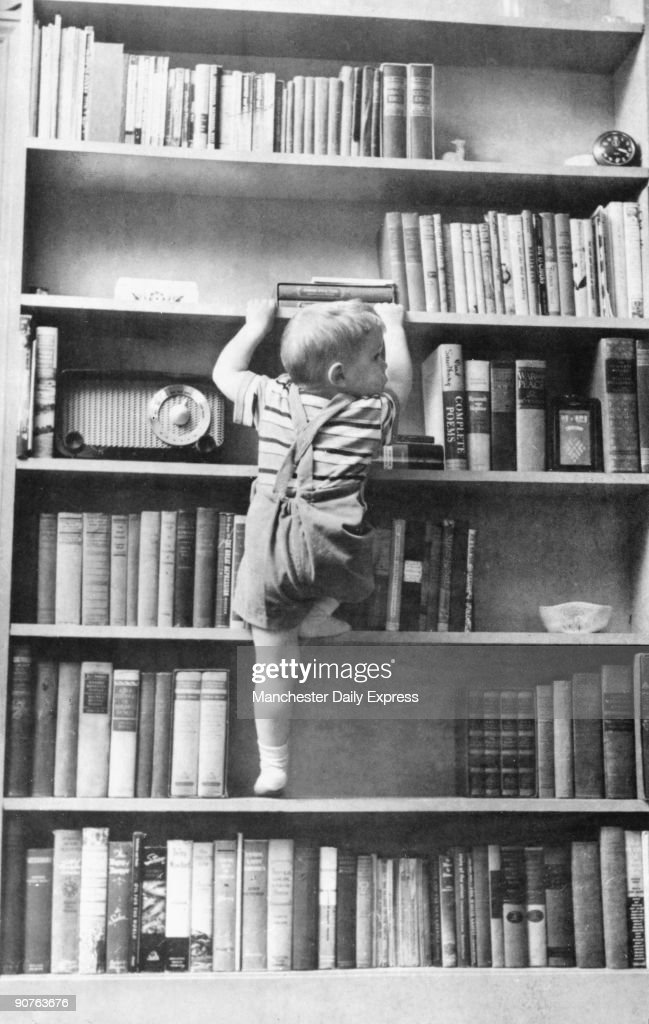�This twoyear old is learning to climb using his father�s bookshelf as a ladder If he reaches the top safely the book or knickknack that has caught...