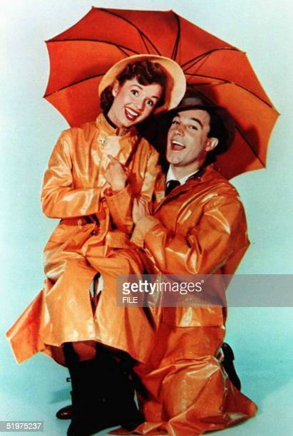 This undated file photo shows US actor Gene Kelly who died 02 February at the age of 83 at his home in Beverly Hills California with actress Debbie...
