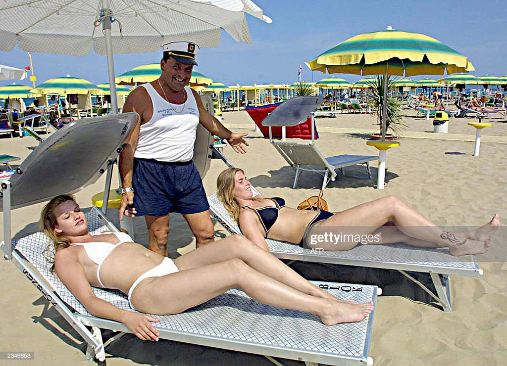 This undated file picture shows German tourists taking a sun bath on the beach in Rimini during a holiday trip The diplomatic row between Germany and...