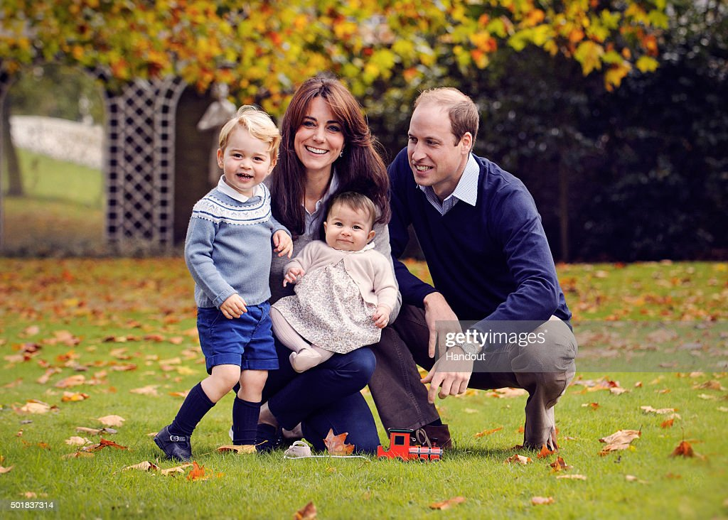 This undated handout image provided by Kensington Palace on December 18, 2015 shows Prince William, Duke of Cambridge and Catherine, Duchess of Cambridge with their children, Prince George and Princess Charlotte, in a photograph taken late October at Kensington Palace. .
