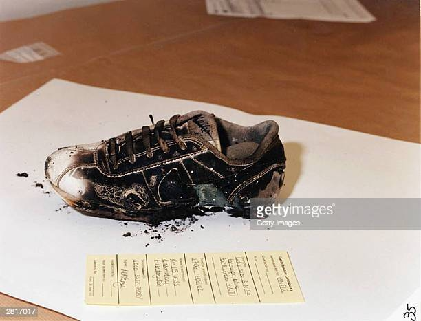 This undated handout photo shows the burnt remains of a shoe belonging to one of the two murdered ten year old girls that were found along with...