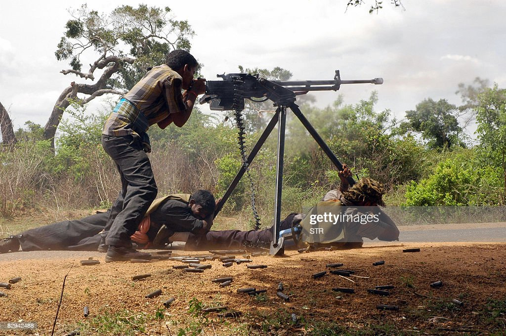 This undated handout picture received from the prorebel pathivucom on September 22 2008 shows a group of Tamil Tiger rebels operating a heavy weapon...