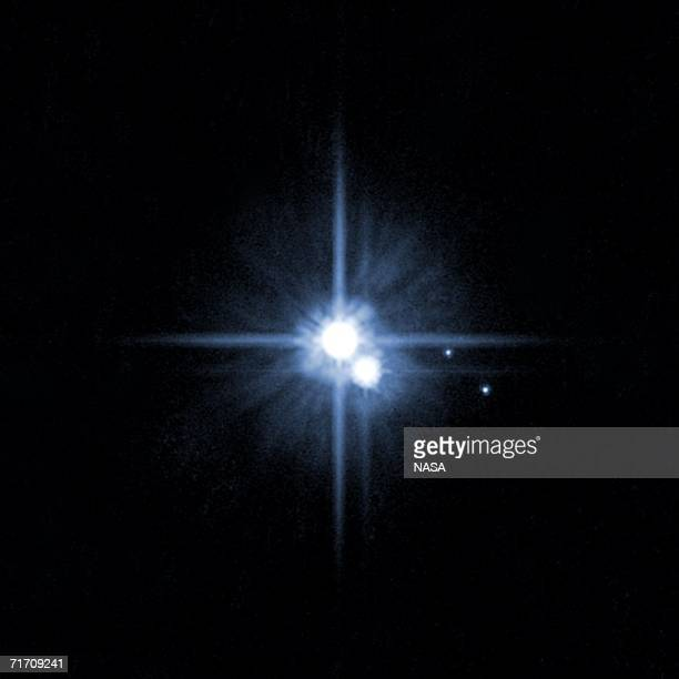 IN SPACE This undated image taken by the Hubble telescope shows Pluto and its moons Charon Nix and HydraThe International Astronomical Union...