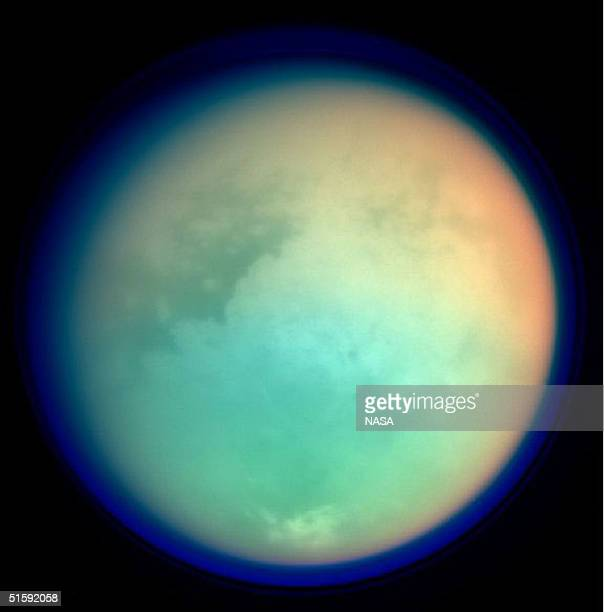 This undated NASA handout shows Saturn's moon Titan in ultraviolet and infrared wavelengths The Cassini spacecraft took the image while on its...
