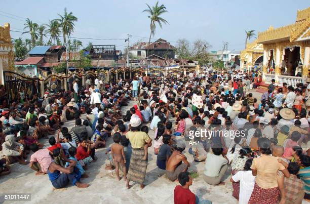 This undated photo received on May 7 2008 shows cyclone affected families waiting for the relief goods under open skies after losing their homes in...