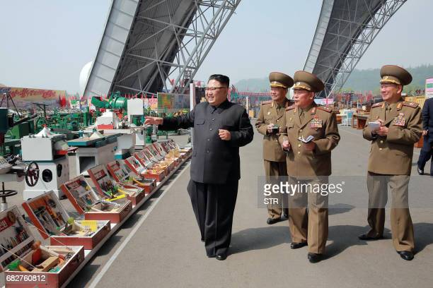 This undated photo released by North Korea's official Korean Central News Agency on May 13 2017 shows North Korean leader Kim JongUn at an exhibition...