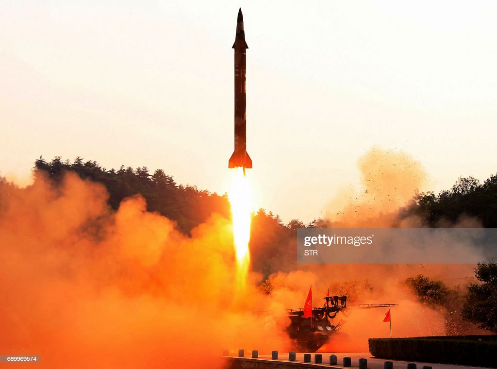 TOPSHOT - This undated photo released by North Korea's official Korean Central News Agency (KCNA) on May 30, 2017 shows a test-fire of a ballistic missile at an undisclosed location in North Korea. PHOTO / KCNA via KNS / STR / South Korea OUT / REPUBLIC OF KOREA OUT ---EDITORS NOTE--- RESTRICTED TO EDITORIAL USE - MANDATORY CREDIT 'AFP PHOTO/KCNA VIA KNS' - NO