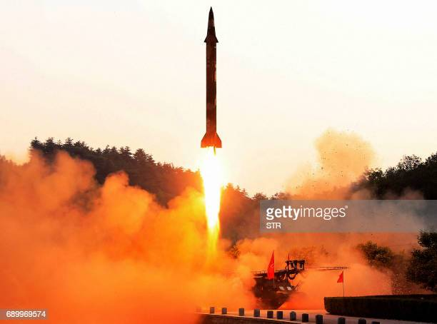 TOPSHOT This undated photo released by North Korea's official Korean Central News Agency on May 30 2017 shows a testfire of a ballistic missile at an...