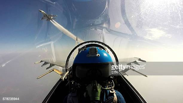 TOPSHOT This undated photo shows two Chinese jet fighters during a military drill in the South China Sea near China's Hainan Island An area off the...
