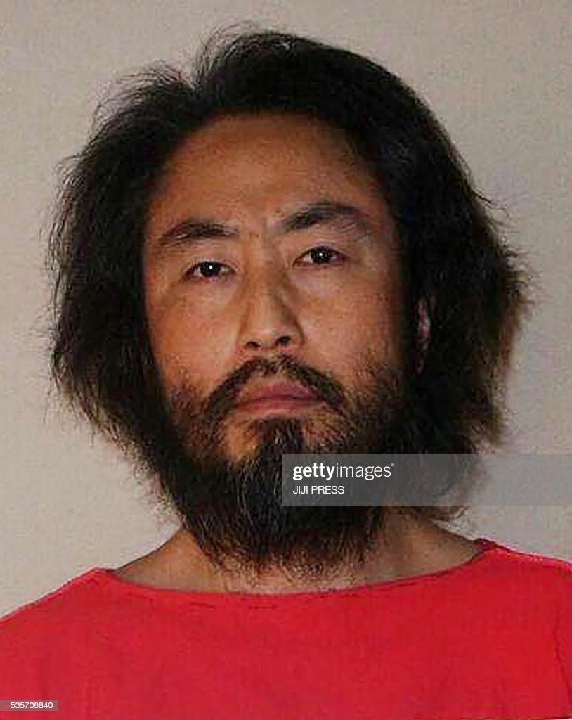 This undated picture provided by Japan's Jiji Press news agency on May 30, 2016 shows Japanese freelance journalist Jumpei Yasuda at an undisclosed location. A fresh photo of a Japanese journalist who went missing in Syria last year has emerged online, showing the heavily bearded man holding a sign saying this is his 'last chance'. / AFP / JIJI PRESS / JIJI PRESS / Japan OUT