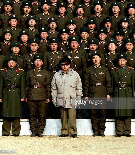 This undated picture released by Korean Central News Agency on January 18 2009 shows North Korean leader Kim Jong Il posing with soldiers as he...