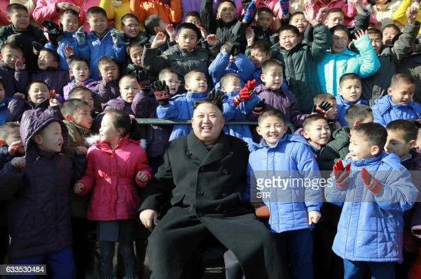 This undated picture released by North Korean news agency KCNA on February 2 2017 shows North Korean leader Kim JongUn posing with the school...