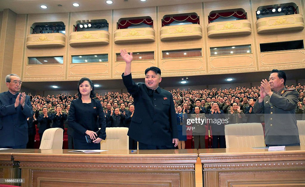 This undated picture, released by North Korea's official Korean Central News Agency (KCNA) on May 13, 2013 shows North Korean leader Kim Jong Un (C), accompanied by his wife Ri Sol Ju (2nd L), enjoying  performance given by the Song and Dance Ensemble of the Korean People's Internal Security Forces (KPISF) in Pyongyang.   AFP PHOTO / KCNA via KNSTHIS PICTURE WAS MADE AVAIALBLE BY A THIRD PARTY. AFP CAN NOT INDEPENDENTLY VERIFY THE AUTHENTICITY, LOCATION, DATE AND CONTENT OF THIS IMAGE. THIS PHOT