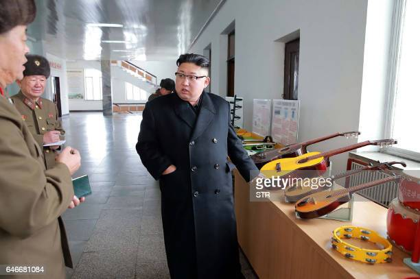 This undated picture released by North Korea's official Korean Central News Agency via KNS on March 1 2017 shows North Korean leader Kim JongUn...