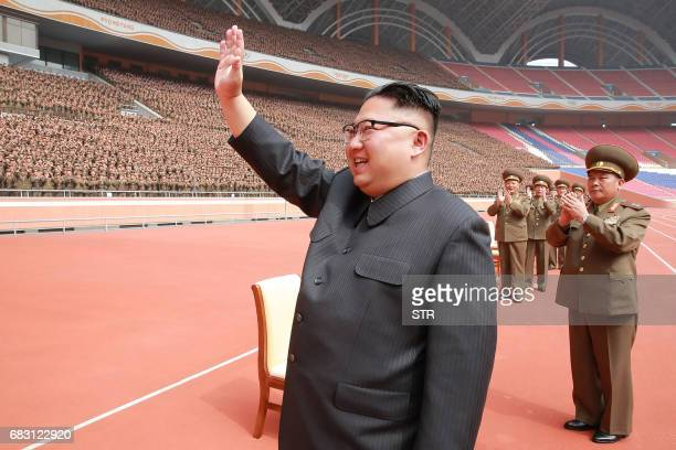 This undated picture released by North Korea's official Korean Central News Agency on May 15 2017 shows North Korean leader Kim JongUn waving to the...