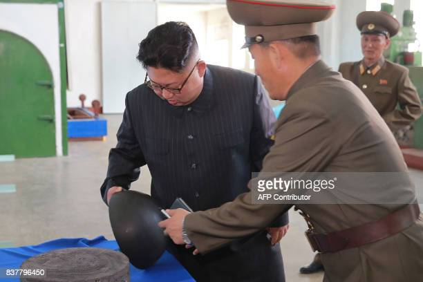 This undated picture released by North Korea's official Korean Central News Agency on August 23 2017 shows North Korean leader Kim JongUn visiting...