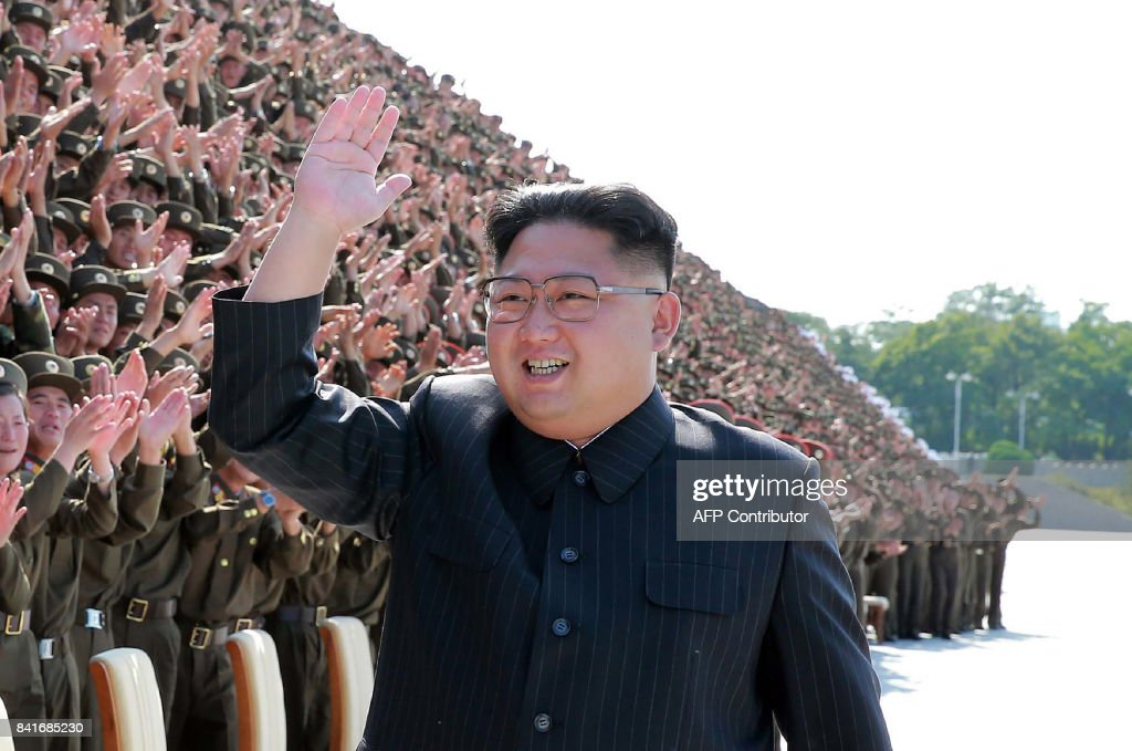 This undated picture released by North Korea's official Korean Central News Agency (KCNA) on September 2, 2017 shows North Korean leader Kim Jong-Un (C) attending a photo session with participants of the fourth conference of active secretaries of primary organisations of the youth league of the Korean People's Army (KPA) in Pyongyang. / AFP PHOTO / KCNA VIA KNS / STR / South Korea OUT / REPUBLIC OF KOREA OUT ---EDITORS NOTE--- RESTRICTED TO EDITORIAL USE - MANDATORY CREDIT 'AFP PHOTO/KCNA VIA KNS' - NO