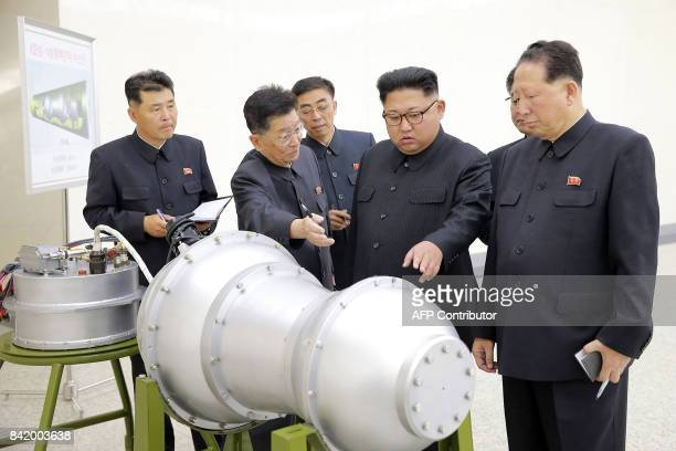 TOPSHOT This undated picture released by North Korea's official Korean Central News Agency on September 3 2017 shows North Korean leader Kim JongUn...