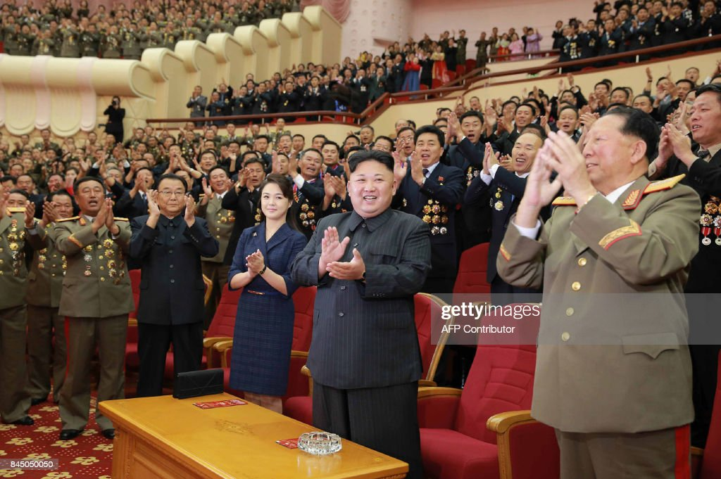 This undated picture released by North Korea's official Korean Central News Agency (KCNA) on September 10, 2017 shows North Korean leader Kim Jong-Un (front 2nd R) and his wife Ri Sol-Ju (front C) attending an art performance dedicated to nuclear scientists and technicians, who worked on a hydrogen bomb which the regime claimed to have successfully tested, at the People's Theatre in Pyongyang. / AFP PHOTO / KCNA VIA KNS / STR / South Korea OUT / REPUBLIC OF KOREA OUT ---EDITORS NOTE--- RESTRICTED TO EDITORIAL USE - MANDATORY CREDIT 'AFP PHOTO/KCNA VIA KNS' - NO